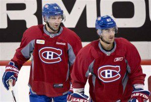 Erik Cole and Max Pacioretty skate during an informal  practice at Brossard. (AP Photo/The Canadian Press, Paul Chiasson)