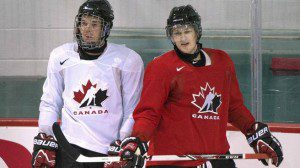 Team Canada hockey prospects Connor McDavid, left, and Nathan MacKinnon of Cole Harbour chat during Canada's National Junior Team training camp in Brossard, Que. (GRAHAM HUGHES / CP)